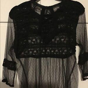Youth size large black lace shirt.